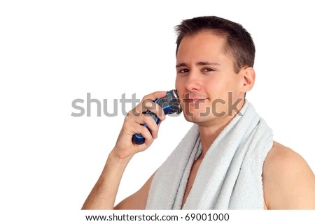 Handsome young man shaving - stock photo