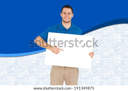 Handsome young man showing card against blue and white background - stock photo