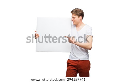 handsome young man showing empty panel on white - stock photo