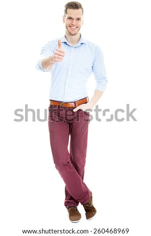 Handsome young man showing thumb up isolated on white - stock photo