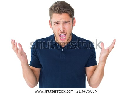 Handsome young man shrugging shoulders on white background - stock photo
