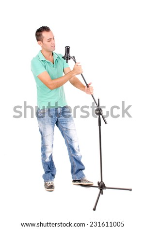 handsome young man singing isolated in white background