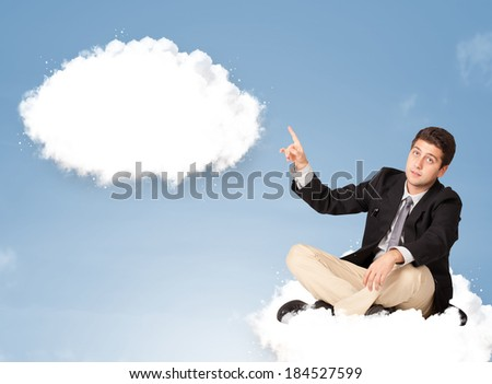 Handsome young man sitting on cloud and thinking of abstract speech bubble with copy space