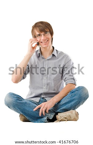 Handsome young man smiling and talking by mobile phone. Isolated over white - stock photo