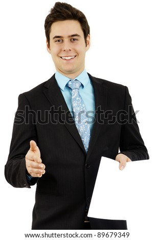 Handsome young man smiling while presenting his hand to meet a future boss and hand out his resume during a job interview, or presenting a contract.