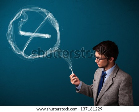 Handsome young man smoking unhealthy cigarette with no smoking sign - stock photo