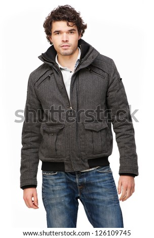 Handsome young man standing with gray jacket - stock photo