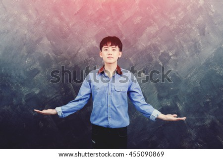 Handsome young man stretched out his hand to both sides for show something. - stock photo