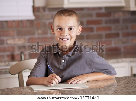 Handsome young man studying and writing - stock photo