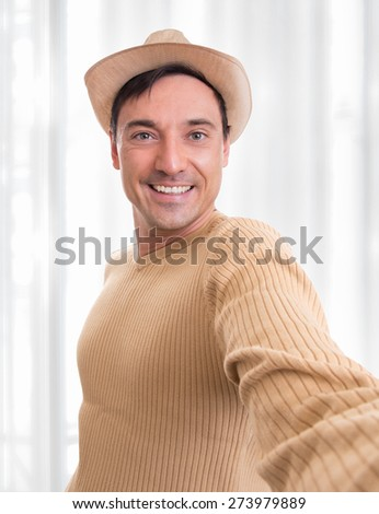 Handsome young man take a self portrait. selfie - stock photo