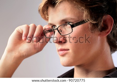 Handsome young man wearing eyeglasses - stock photo