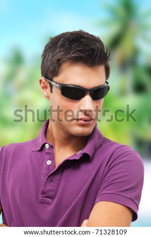 Handsome young man wearing sunglasses - stock photo
