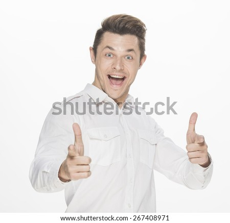 Handsome young man  winning and celebrating, thumbs up gesture, isolated on white - stock photo
