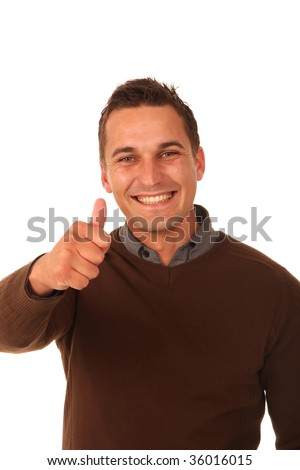 Handsome young man with a big smile and thumbs up sign
