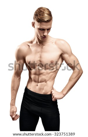 handsome young man with a muscular torso and abdominal muscles - stock photo