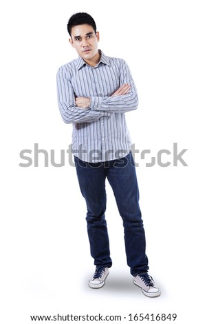 Handsome young man with arms folded. Isolated on white background