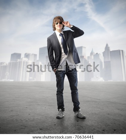 Handsome young man with cityscape on the background
