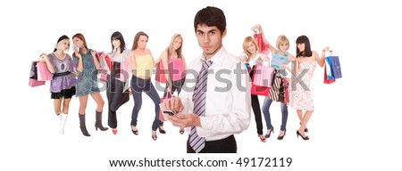 Handsome young man with group of happy cute smiling adult girls with shopping bags on background - stock photo