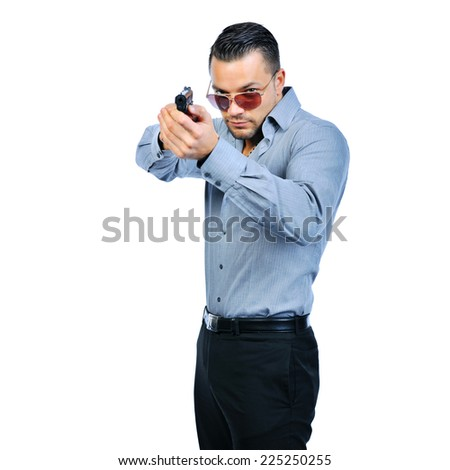 Handsome young man with gun isolated - stock photo