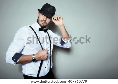 handsome young man with hat and wrist watch - stock photo