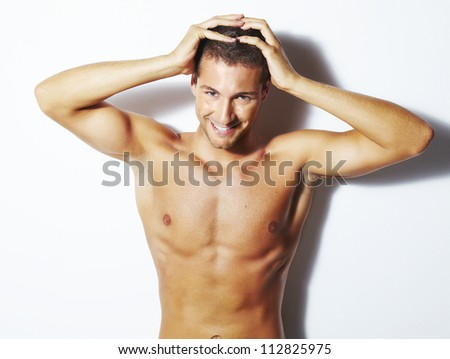 Handsome young man with healthy hair. Studio shoot over white background - stock photo