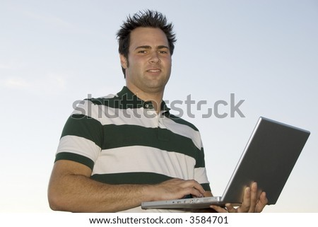 handsome young man with notebook computer