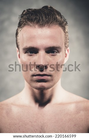 Handsome young man with slick combed blonde hair. Male beauty shot. Studio portrait.