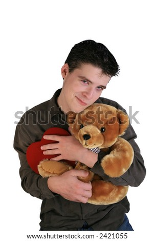 Handsome young man with teddy bear and red heart