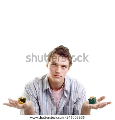 handsome young man with two little gifts - stock photo
