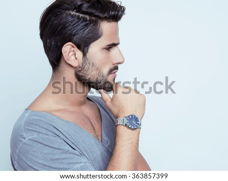 handsome young man with wrist watch - stock photo