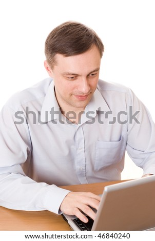 handsome young man working with laptop on white background
