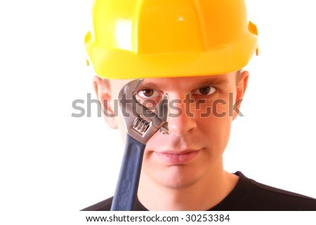 Handsome young men in a yellow building helmet and spanner in the hand isolated on white