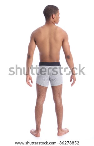 Handsome young mixed race mans fit healthy toned body from behind wearing grey jockey underwear only. - stock photo