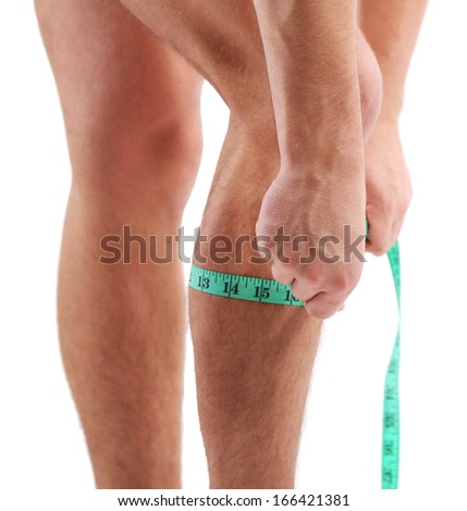 Handsome young muscular sportsman with measuring tape, isolated on white - stock photo