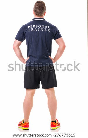 Handsome young personal trainer with clipboard, standing isolated on white background - stock photo