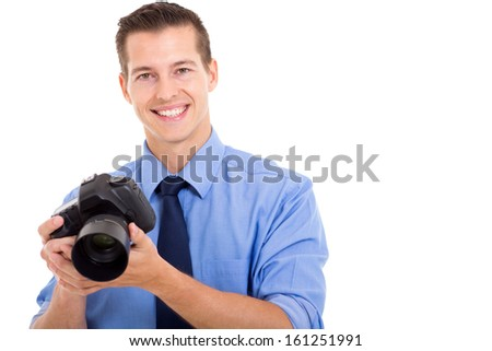 handsome young photographer holding a camera on white background - stock photo