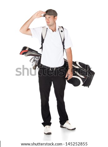 Handsome young professional golf player wearing a white shirt and black pants. He is carrying a golf bag on his back and is looking out. - stock photo