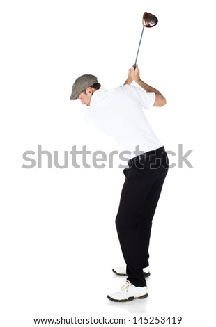 Handsome young professional golf player wearing a white shirt and black pants. He is holding and swinging a golf club and looking out. - stock photo