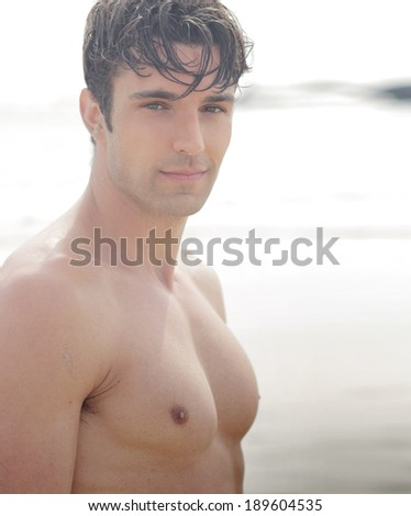 Handsome young shirtless man outdoors