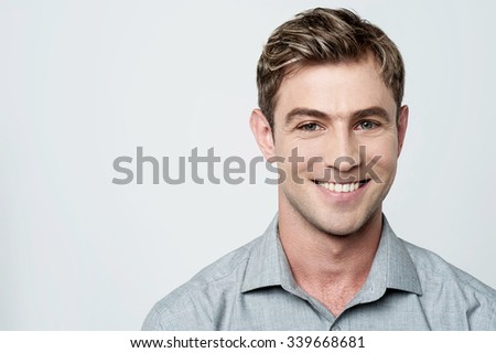 Handsome young smiling guy - stock photo