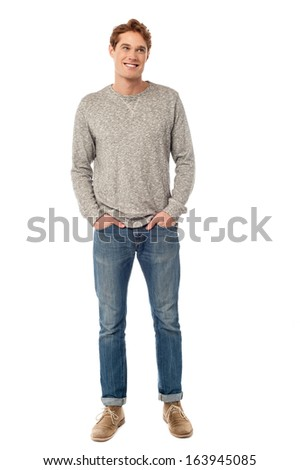 Handsome young stylish guy posing against white