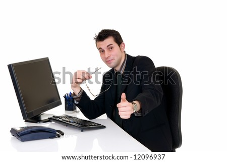 Handsome young successful businessman in the office, working on computer,  white background,  studio shot.