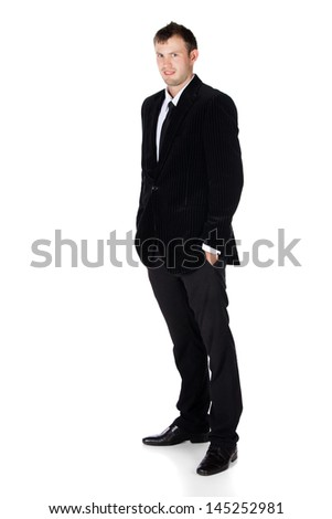 Handsome young successful caucasian businessman wearing a formal black suit, tie and white shirt.