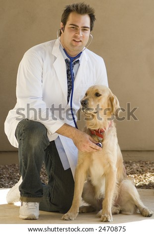 Handsome young vet with Golden Retriever