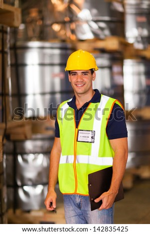 handsome young warehouse worker inside storage - stock photo
