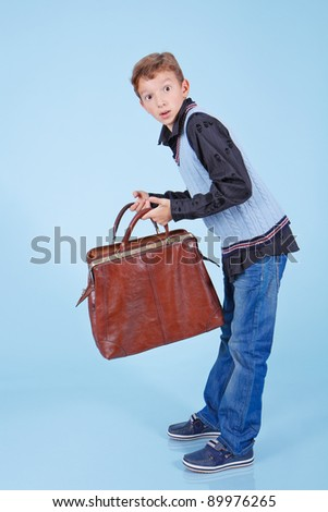 Handsome young with carpetbag - stock photo
