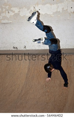 handstand on skates in skate hall - stock photo