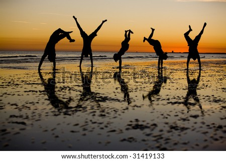 Handstands at Sunset - stock photo