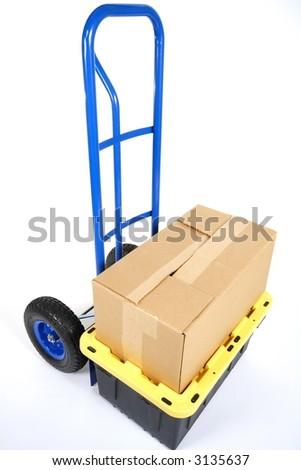 Handtruck (dolly) and boxes ready for moving - stock photo