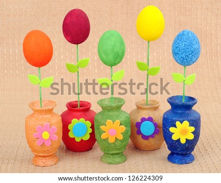 Handwork vases with the painted Easters eggs - stock photo